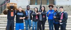 Fraternity and Sorority members standing on MU steps with Benny