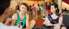 students converse in Student Experience Center