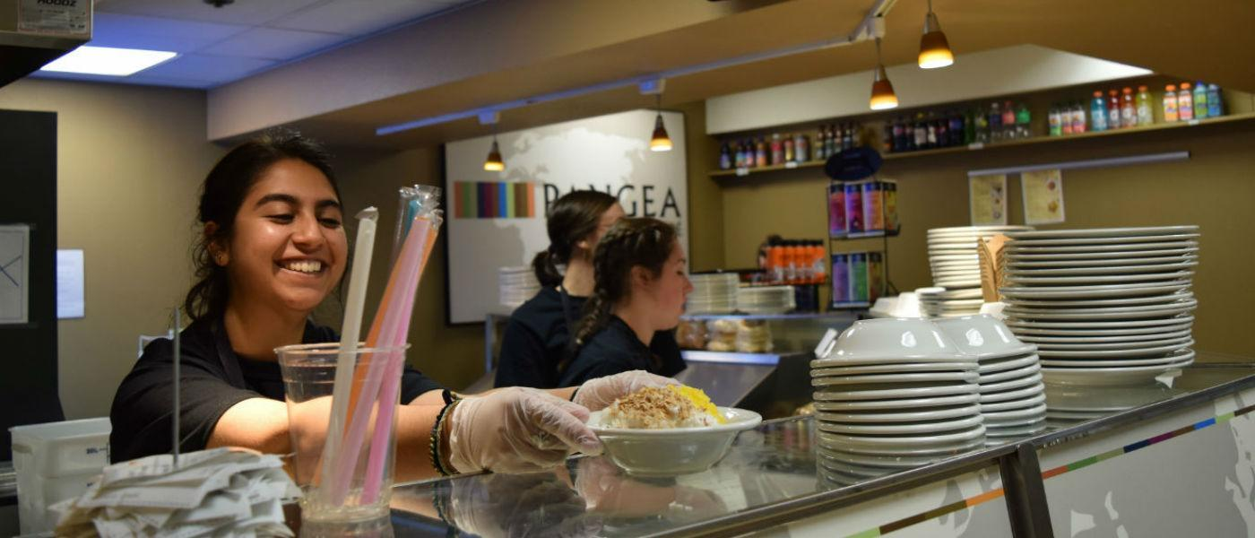 Students prepare food during the Pangea Cafe Takeover Event