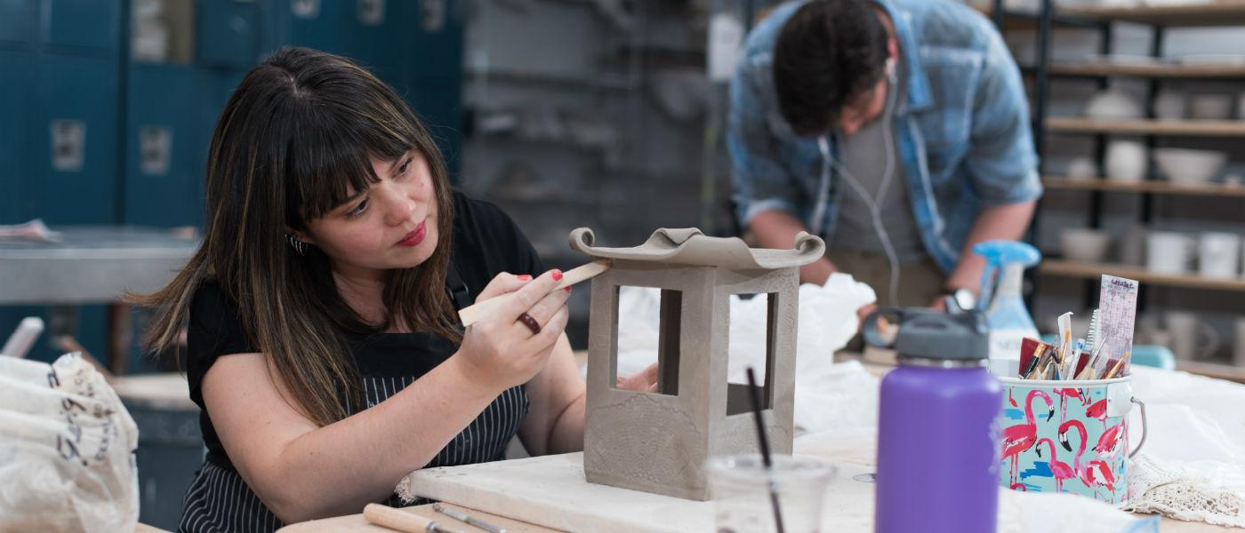 Student uses clay to make small house